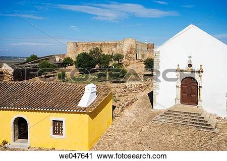 Stock Photography of House and chapel in the Castro Marim castle.