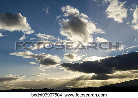 "Stock Photo of ""Sun rays breaking through the clouds in the."