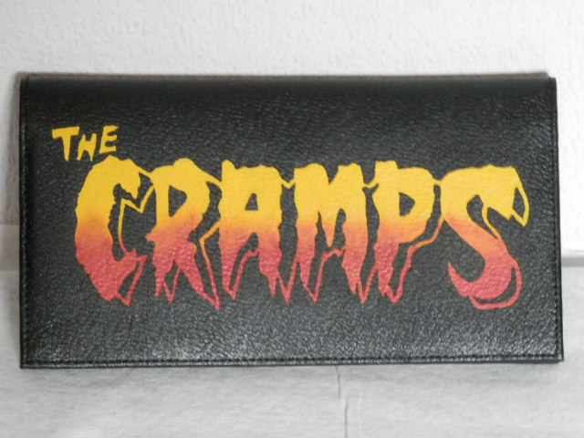 Leather wallet custom painted with The Cramps logo.