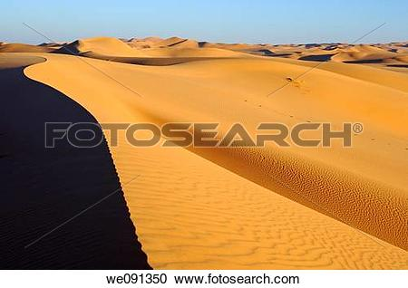Stock Photography of Sharp crest and sand structures in the sand.