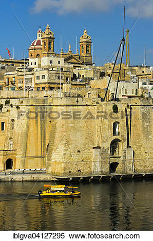 Stock Image of Ferry passing the fortifications of Senglea, Church.
