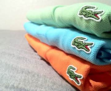The green crocodile logo belongs to what clothing and.
