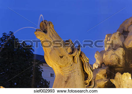 Stock Photo of Austria, Salzburg, Statue of horse head at.
