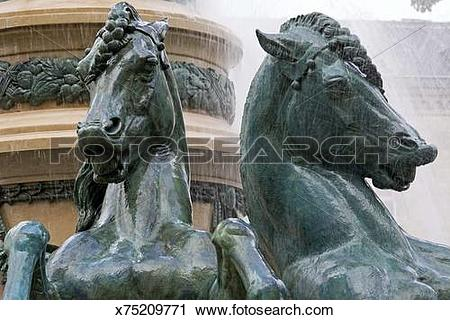 Stock Photography of Copper horse statues in fountain.