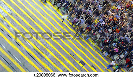 Stock Images of Pedestrians hustle and bustle like bees in large.