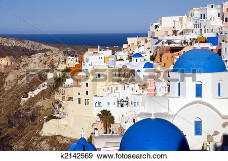 Stock Photograph of blue dome churches and classic cyclades.