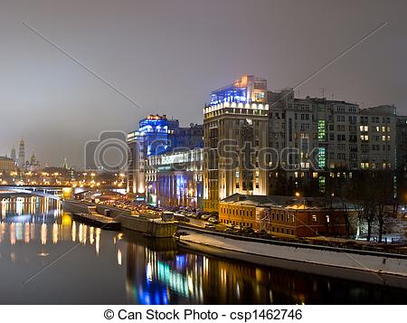 Stock Image of Big highlighted house on the Moscow river.