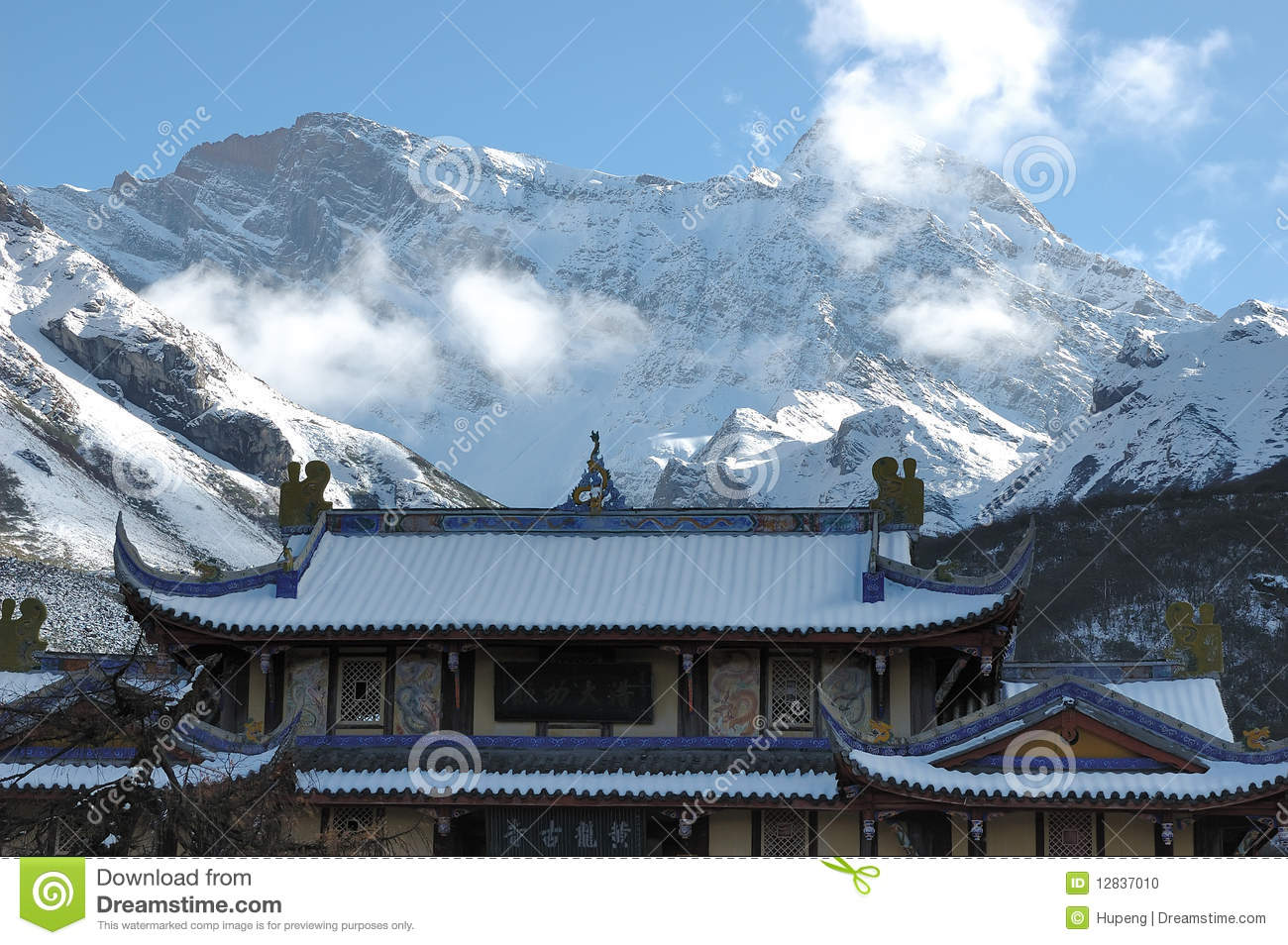 Golden Temple Roof And Snow Mountain Royalty Free Stock Photo.