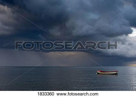 Stock Photography of Empty boat floating in the North Sea.