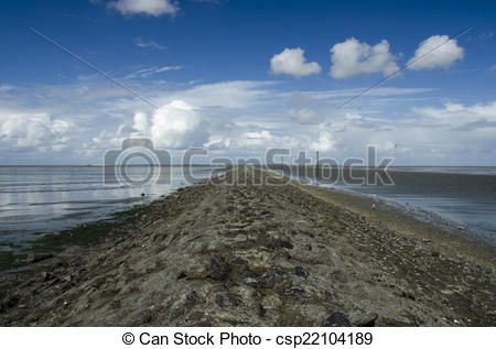 Stock Illustration of Old dam on the North Sea at low tide.