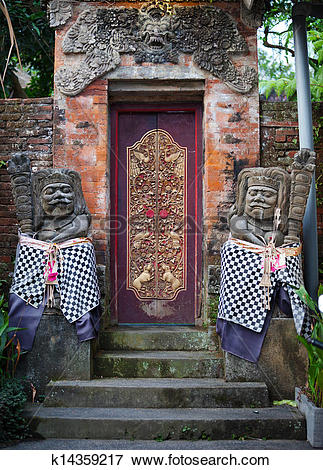 Picture of Gates of the old temple with stone guards. Indonesia.