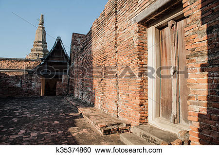 Stock Photography of Ruins of the old walls & Buddha statue in The.