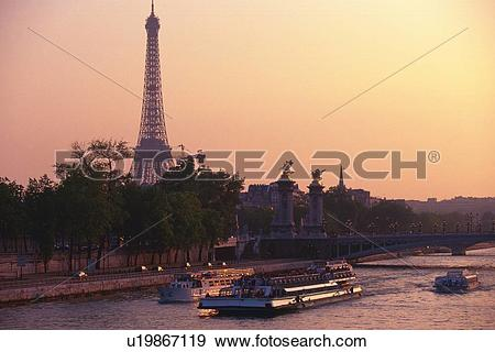 Stock Photograph of Image of Several Boats on the Seine by Sunset.