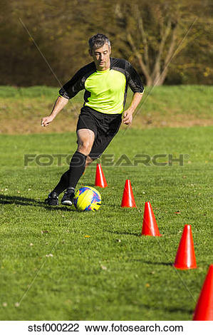 Stock Photo of Soccer player passing a slalom course stsf000222.