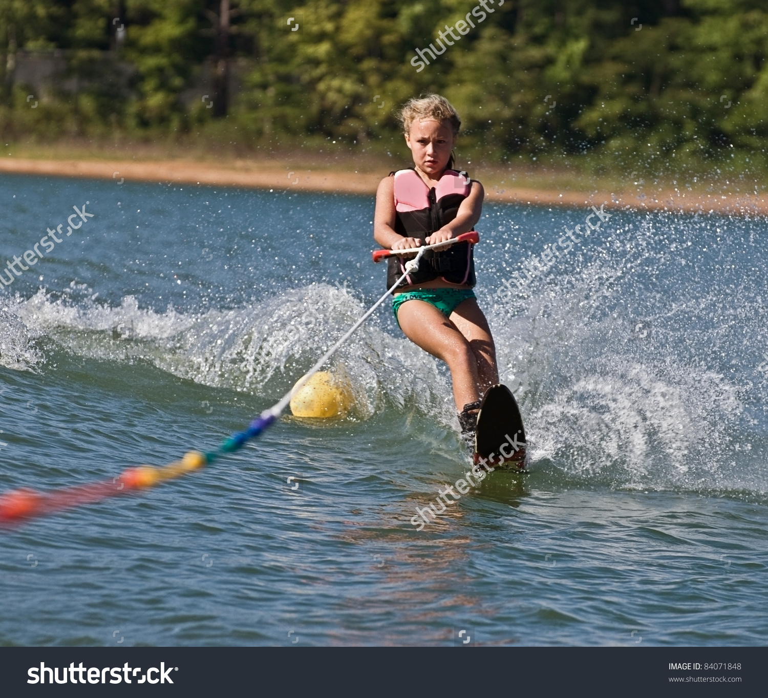 Young Girl Water Skiing On Slalom Stock Photo 84071848.