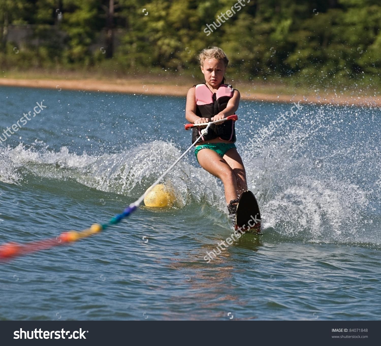 Young Girl Water Skiing On Slalom Stock Photo 84071848.