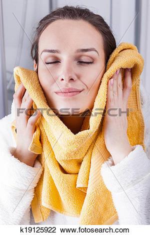 Stock Photo of Enjoying the softness of a towel k19125922.