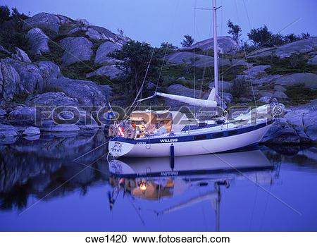 Stock Photography of Sailboat anchored off small island at Stora.