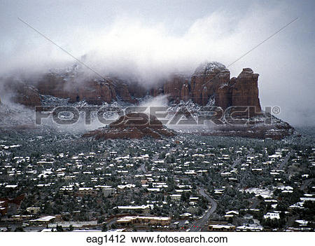 Stock Photo of SNOW dusts the city rooftops and mist hovers over.
