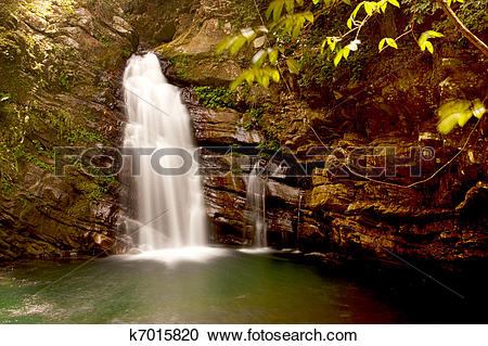 Stock Photography of a cascade on rock falling into lake k7015820.