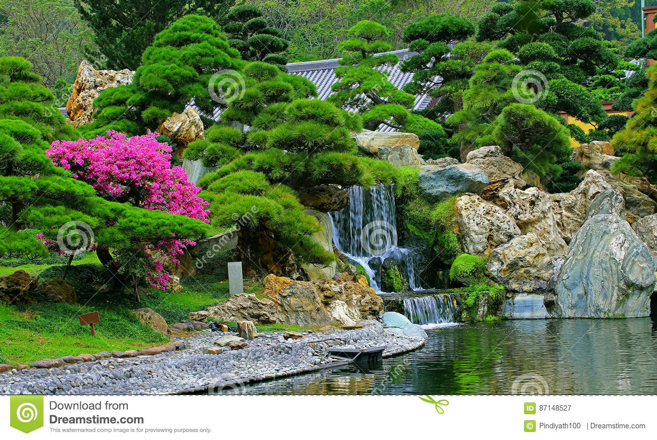 Chinese Zen Garden With Water Fall And Cascade Plants Stock Photo.