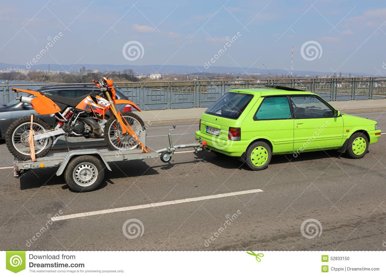 Green Car With Orange Dirt Bike On Theodor Heuss Bridge Editorial.