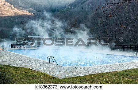 Stock Photo of Thermal spring with swimming pool in mountain.