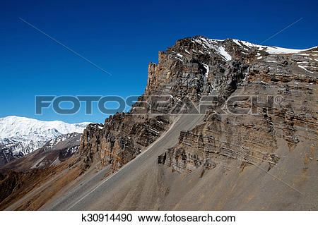 Stock Photography of Mountain peak n Thorong La pass k30914490.