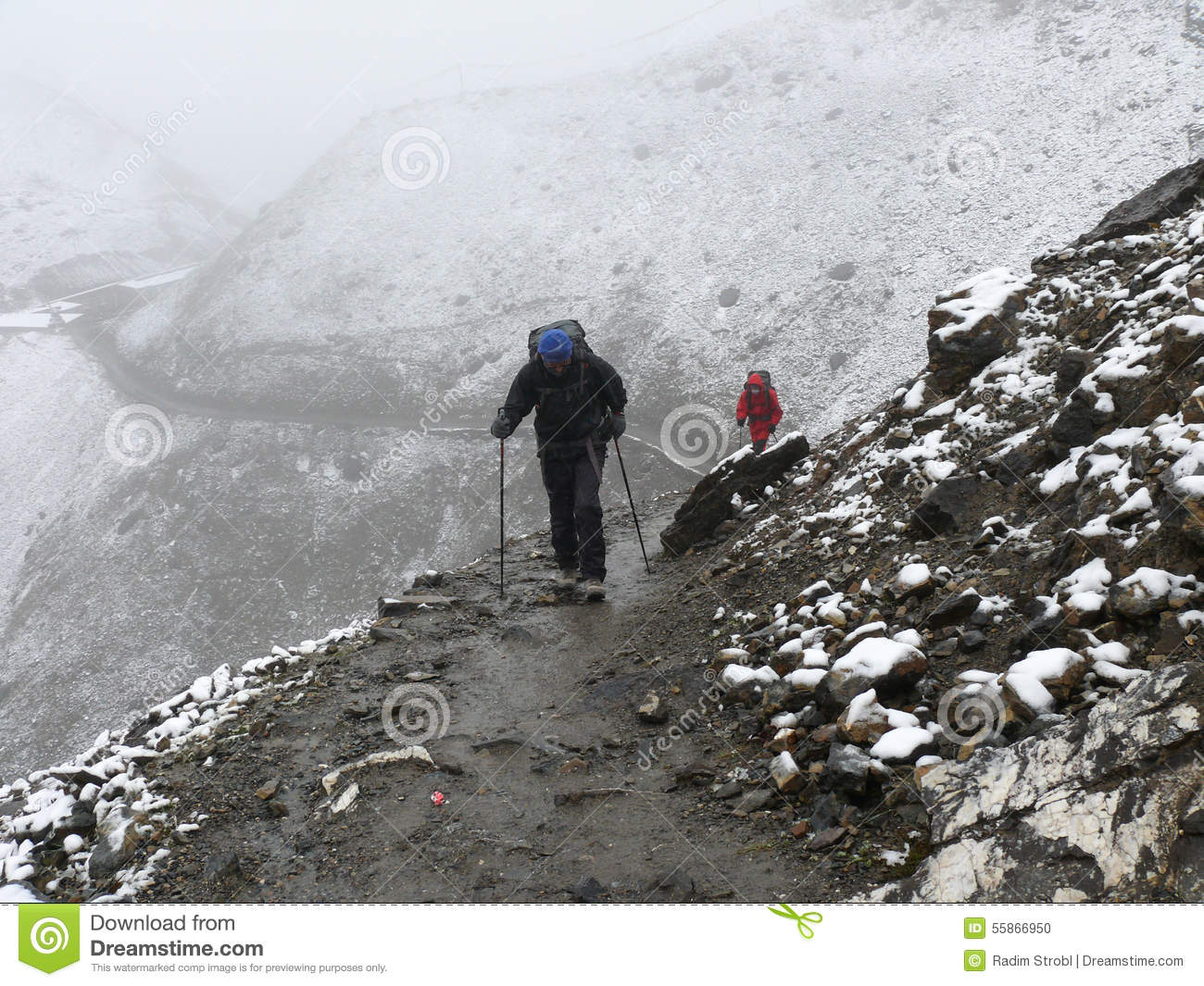 Cold Snowy Weather On Way To Thorong La Pass, Nepal Stock Photo.