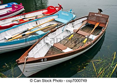 Stock Photographs of Group of rowing boats at Thorpeness boating.