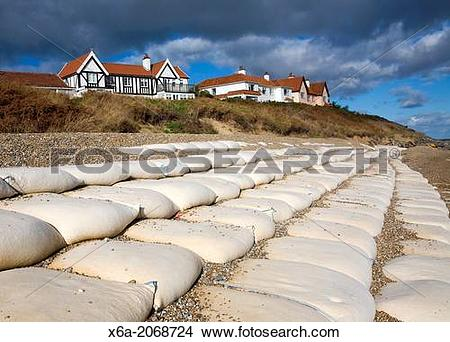 Stock Photo of Winter storms have removed shingle and exposed sea.