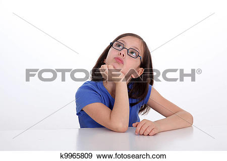 Stock Photograph of Portrait of little girl with thoughtful look.