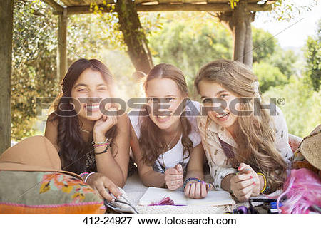 Picture of Three teenage girls having fun in tree house in summer.