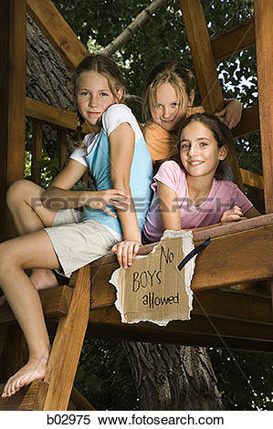 Stock Image of Portrait of three girls smiling and sitting in a.