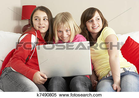 Stock Image of Group Of Three Girls Using Laptop At Home k7490805.