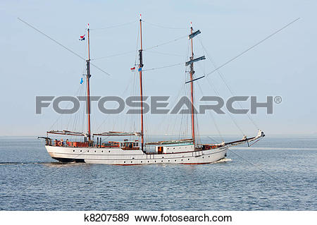 Stock Photograph of Typical old Dutch three mast clipper sailing.
