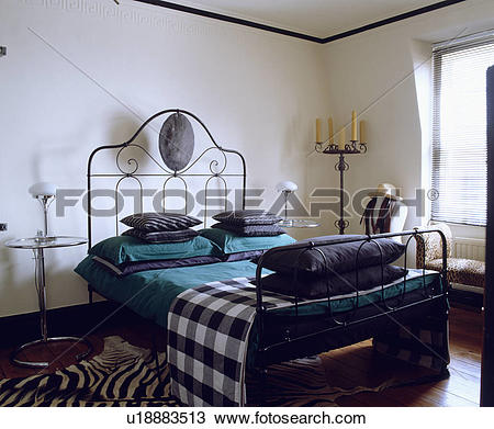 Stock Photo of Checked throw and turquoise pillows on modern.