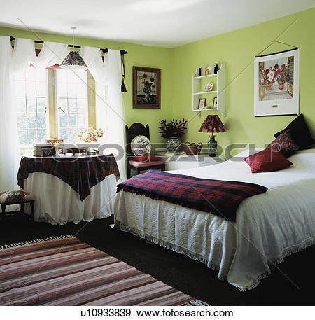 Stock Photograph of Tartan throw on bed in lime.