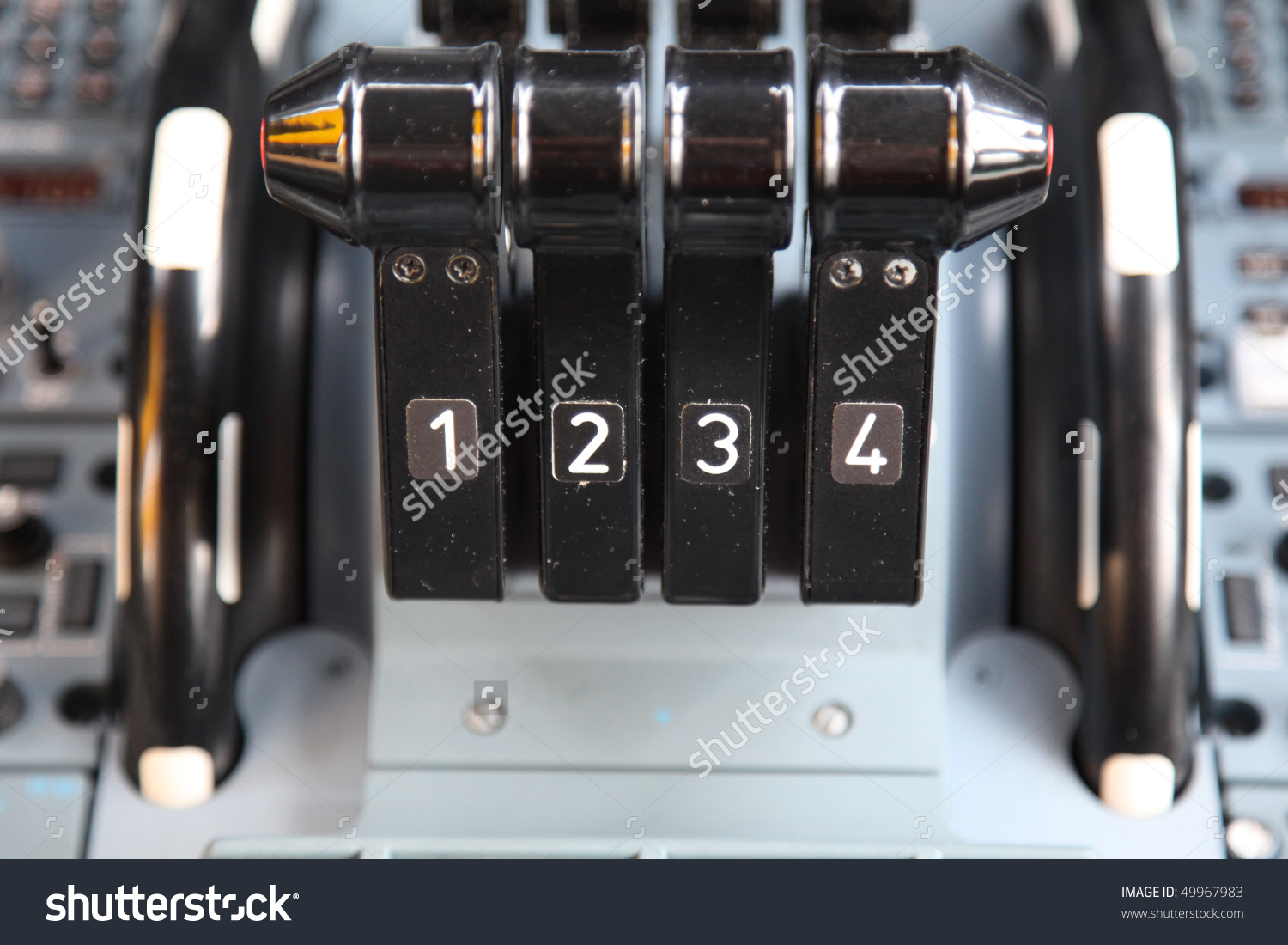 Jet Airplane Four Thrust Levers In The Cockpit Stock Photo.