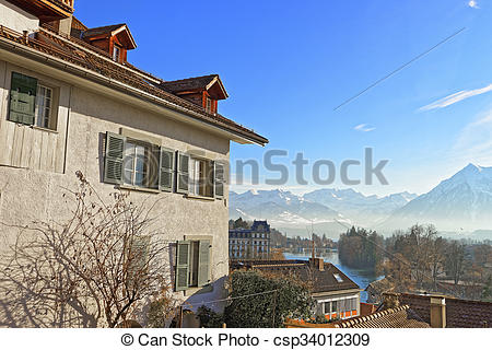Stock Photography of Panorama of Thun Town with Thunersee and Alps.