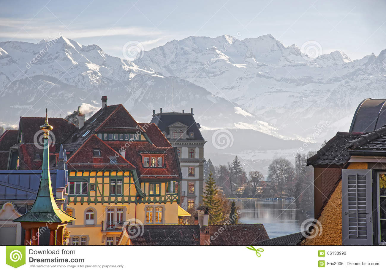 Panorama Of Houses In Thun And The Alps And Thunersee Stock Photo.