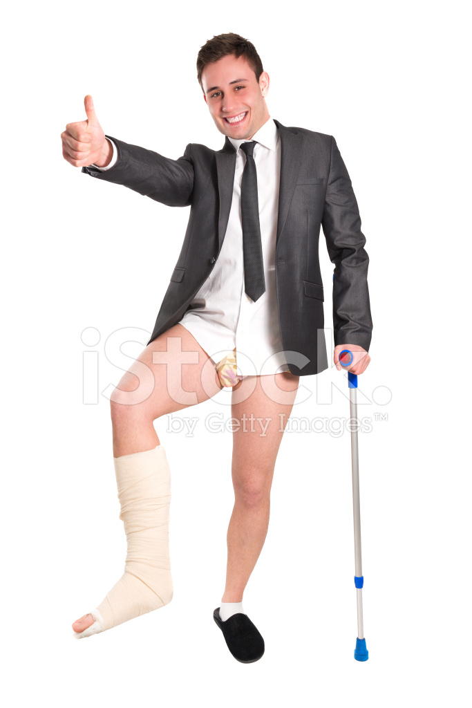 Young Businessman With Crutches, Broken Leg and Thumbs UP.