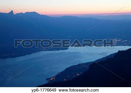 Stock Photograph of Lake Thun and mountains at dusk, Niederhorn.