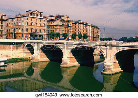 Stock Photograph of Arch bridge across a river, Tiber River, Rome.
