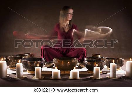 Stock Photography of Playing Tibetan bowls k33122170.