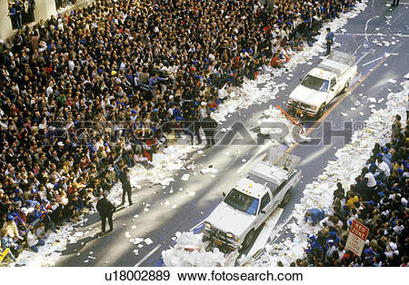 Stock Photograph of Trucks Cleaning Paper During Ticker Tape.
