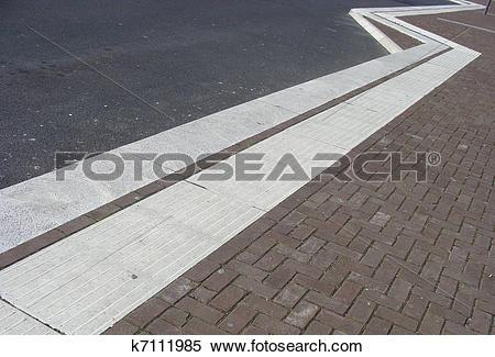 Stock Image of zig zag tile pavement with asphalt road k7111985.
