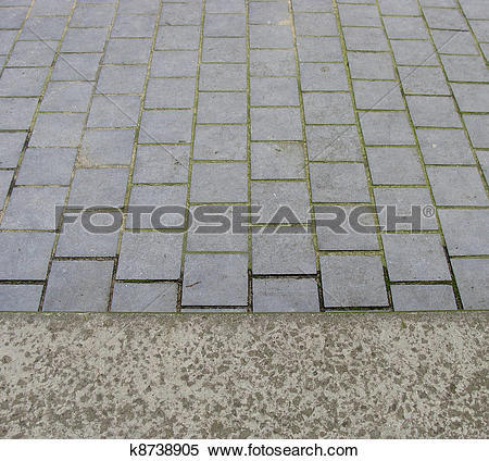 Stock Image of side walk trottoir view with tiled pavement.