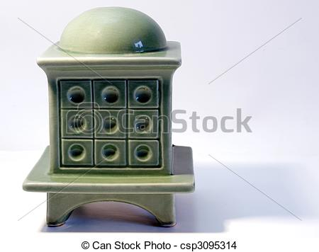 Stock Photo of Miniature model of a tiled stove on white.