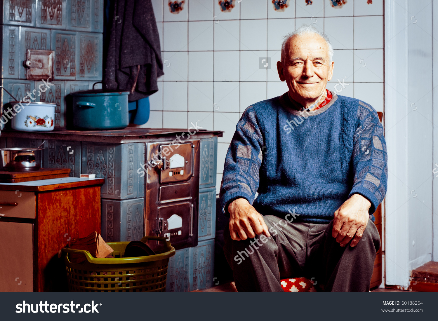 Old Man Sitting By His Tile Stock Photo 60188254.